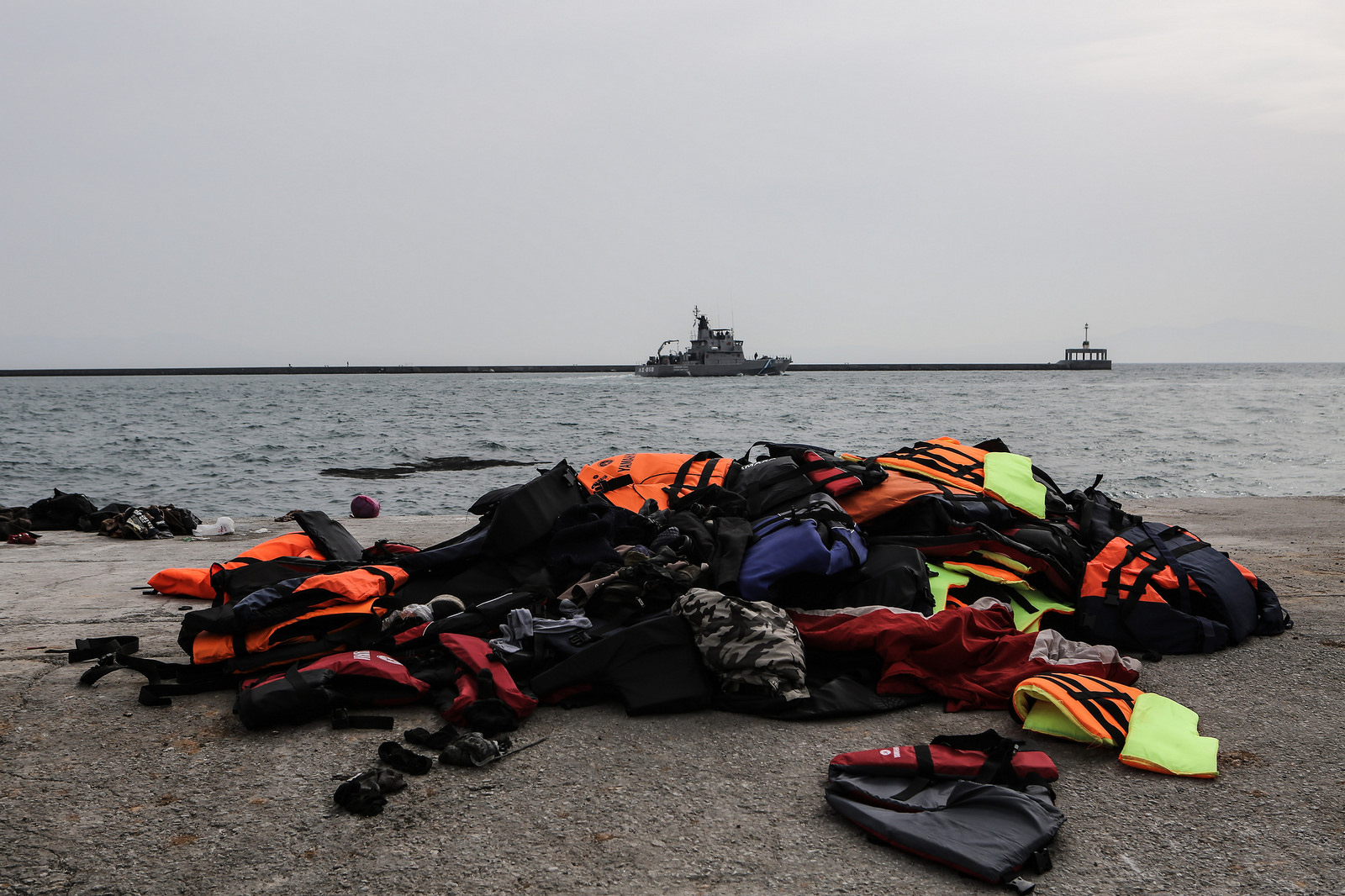 Life jackets and costguard boats at commerce port in Lesvos, Mytilene. Photo by Lefteris Partsalis, Caritas Switzerland.